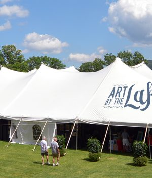 The Art by the Lake tent overlooking Otsego Lake.